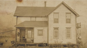 Back view of the Yungen House in 1907 with Jakob Yungen on the left porch and Elise on the right.